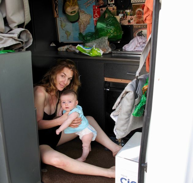 Trujillo with her daughter, Soleil, inside their van in Playa Hermosa, Peru, in