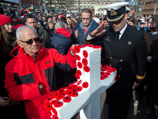 Canadians place poppies on white crosses at a Remembrance Day ceremony in Halifax on