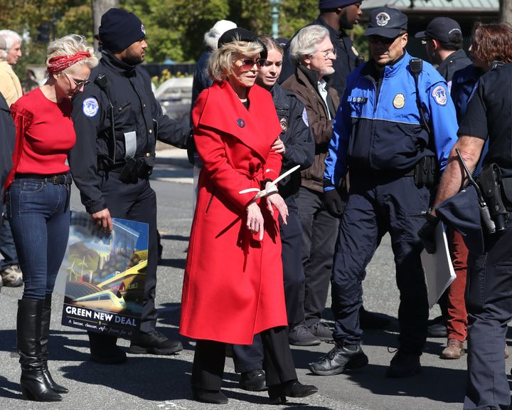 "Jane Fonda is arrested for blocking a street in front of the U.S. Capitol during a ""Fire Drill Fridays"" climate c"