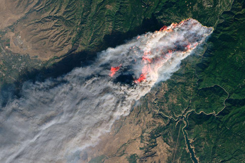 NASA's Operational Land Imager satellite image shows the Camp Fire burning near Paradise, California, on Nov. 8, 2018.