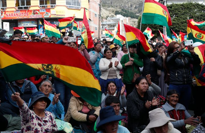Protesters opposing the reelection of Bolivian President Evo Morales attend a rally with coca leaf growers in La Paz, Bolivia