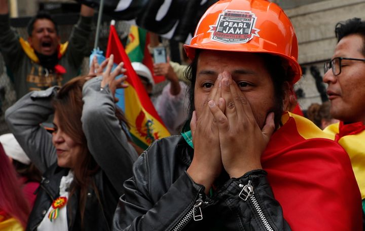 Opponents of Evo Morales react after his resignation announcement on Nov. 10, 2019.