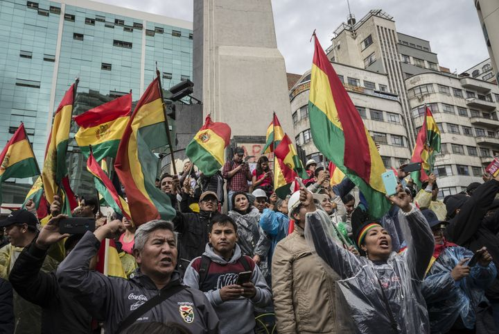 Thousands of people from the opposition celebrate after President of Bolivia Evo Morales announced his resignation in La Paz