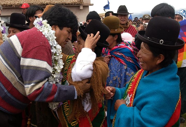 Evo Morales, left, greets supporters at the archaeological site of Tiawanacu, Bolivia, on the eve of his inauguration as Boli