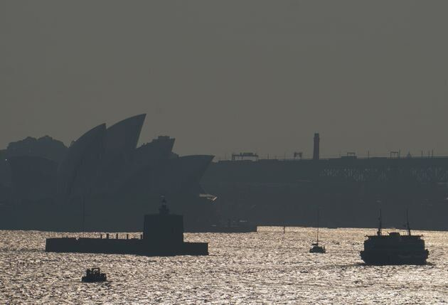 The Sydney Opera House is seen through smoke from bushfires in Sydney, Australia, November 11, 2019.