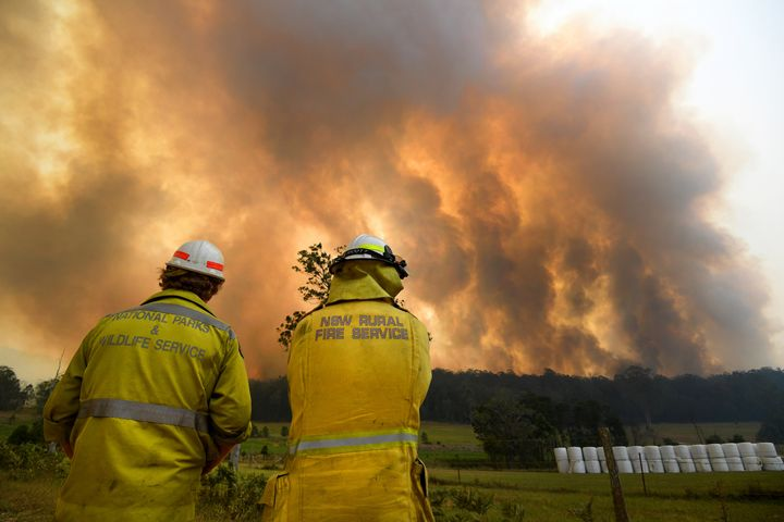 Smoke from a large bushfire is seen outside Nana Glen.