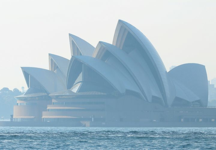 Smoke from bushfires shrouds the Sydney Opera House in Sydney.
