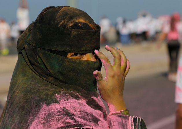 A woman wearing a Niqab participates in the colored powder event the Color Run, in Jeddah, Saudi Arabia,...