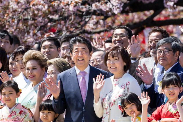 TOKYO, JAPAN - APRIL 13: Japan's Prime Minister Shinzo Abe (C-L) and his wife Akie (C-R) pose for photographs...
