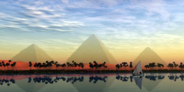 The Great Pyramids stand majestically over the Nile River running through the land of