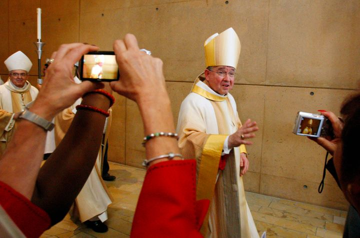 Archbishop Jose Gomez is surrounded by parishioners as he leaves the Cathedral of Our Lady of the Angels following his welcome mass in Los Angeles May 26, 2010.
