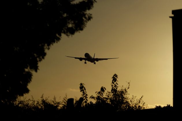 A plane comes in to land at Heathrow Airport in