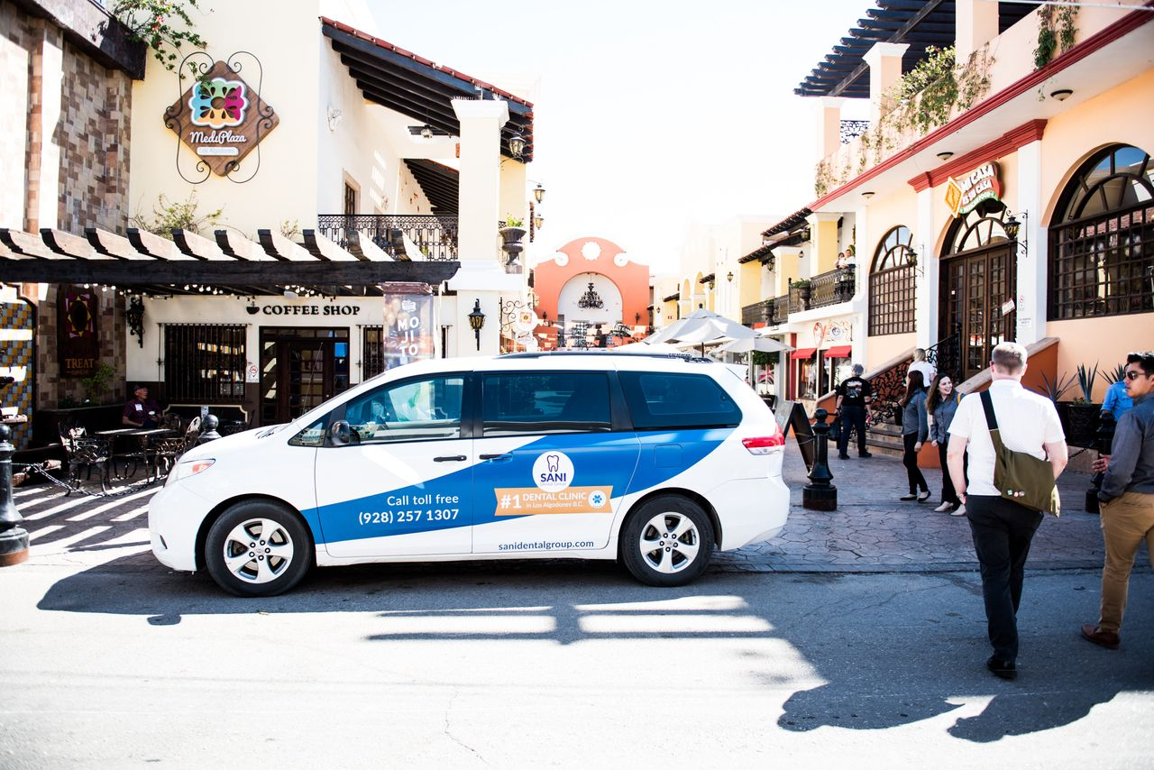 The Sani Dental Group's shuttles are a common sight throughout Molar City, taking patients wherever they'd like to go in Los Algodones, Baja California, Mexico on Saturday Oct. 23, 2019. Some dental practices in town offer transportation to and from the airport in Yuma, Arizona.