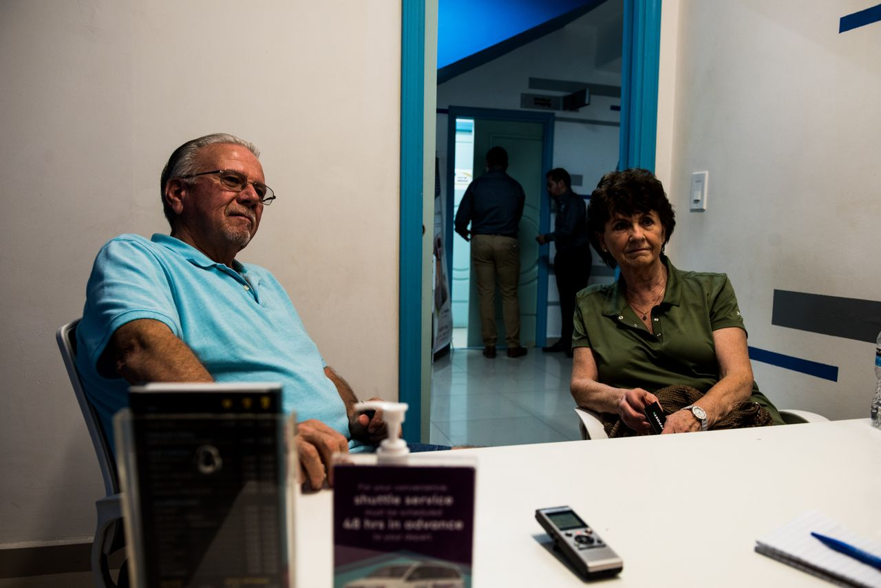 Dan, 77, and Donette Brower, 75, of Spokane, Washington, sit in the consultation room before getting new X-rays and routine cleanings at Sani Dental Group in Los Algodones, Baja California, Mexico, on Oct. 23, 2019.