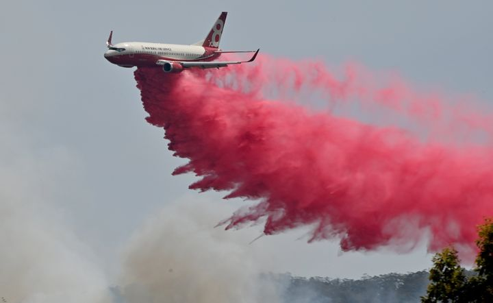 Rural NSW Fire Service plane drops fire retardent on an out of control bushfire near Taree, 350km north of Sydney.