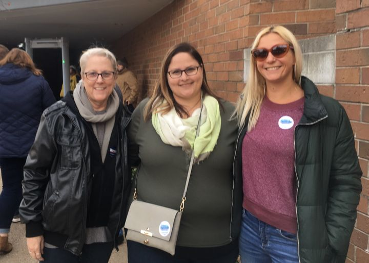 Janet Shoeman (left) and her daughters, Anna Shoeman and Jessica Borrer, attend a Bernie Sanders campaign rally in Des Moines