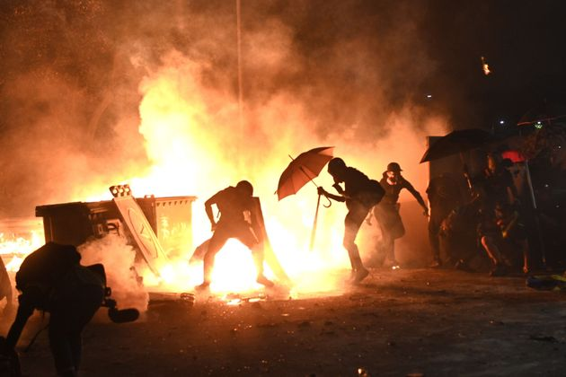 TOPSHOT - Protesters set up a fire during clashes with police at the Chinese University of Hong Kong...