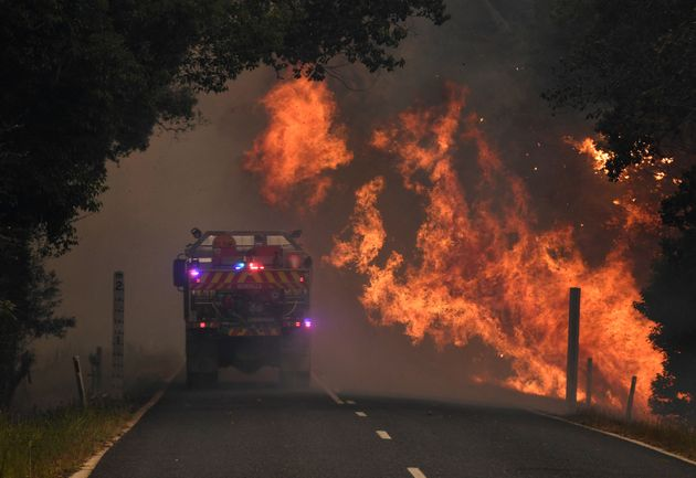 A fire truck is seen near a bushfire in Nana Glen, near Coffs Harbour on