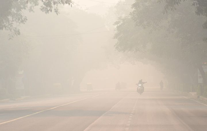 Smog and pollution on Bhagwan Dass road near Mandi House during the morning on November 12, 2019 in New Delhi.