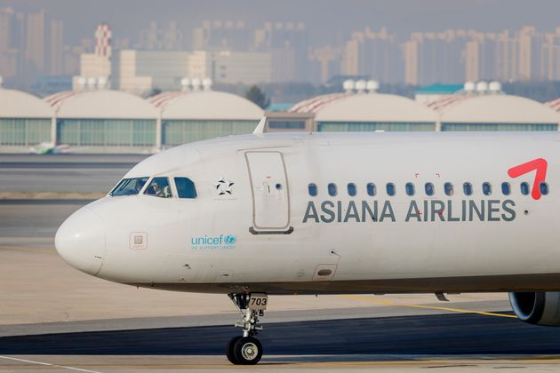 SEOUL, SOUTH KOREA - APRIL 17: An Asiana Airlines Airbus A321 taxis down the runway at Gimpo International...