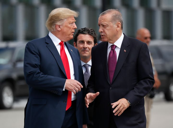 In this Wednesday, July 11, 2018, file photo, President Donald Trump, left, talks with Turkey's President Recep Tayyip Erdoga