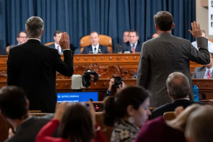 Ukrainian Ambassador Bill Taylor, left, and Deputy Assistant Secretary of State George Kent are sworn before testifying at the first public hearings held by the House Intelligence Committee as part of the impeachment inquiry into President Donald Trump.
