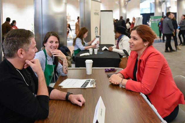 Starbucks Canada interviews a candidate at a refugee hiring event in Toronto on Oct.