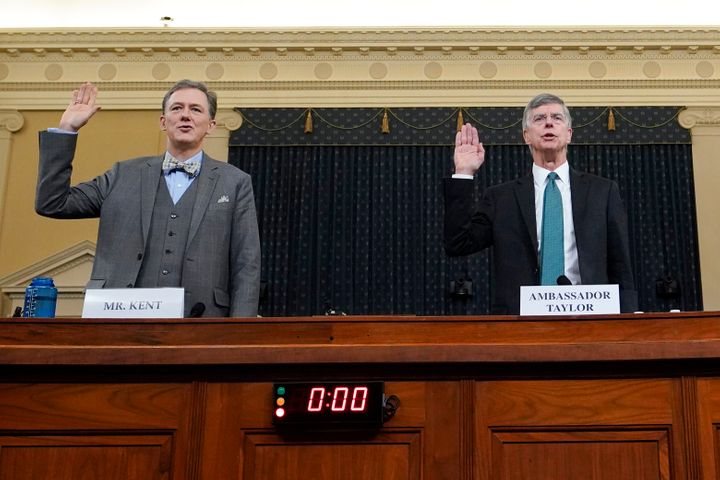 State Department official George Kent (left) and top U.S. diplomat in Ukraine William Taylor are sworn in prior to testifying