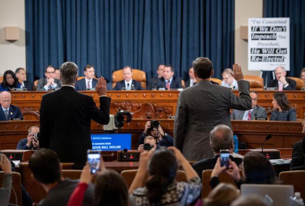 Ukrainian Ambassador William Taylor (L) and Deputy Assistant Secretary George Kent are sworn-in prior...