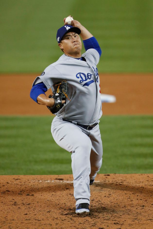 Los Angeles Dodgers starting pitcher Hyun-Jin Ryu throws to a Washington Nationals batter during the...