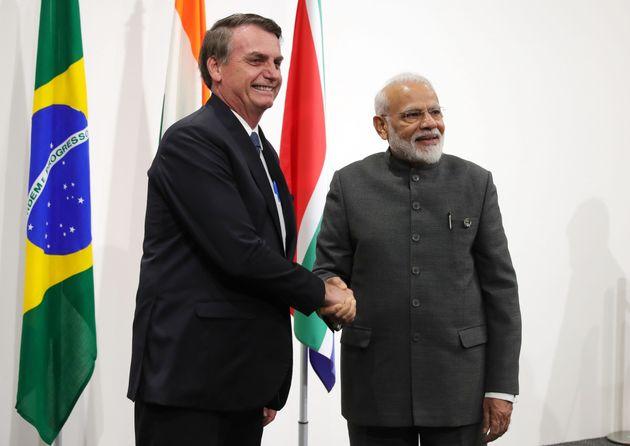 Brazilian President Jair Bolsonaro (L) shakes hands with India's Prime Minister Narendra Modi during...