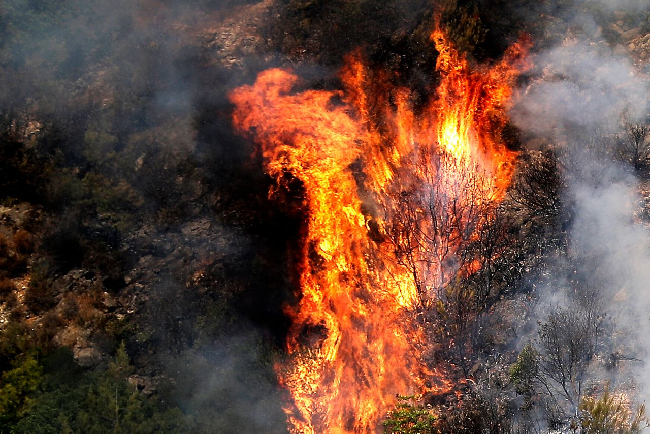 Fire takes out forests in the mountainous area that flanks the Damour river near the village of Meshref in Lebanon's Shouf mountains, southeast of the capital Beirut, on Oct. 15. The outbreak coincided with high temperatures and strong winds.