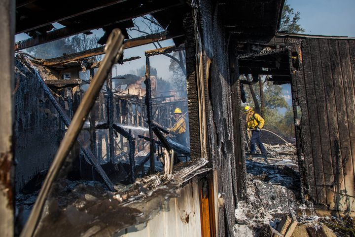 Firefighters battle the Getty Fire in houses in Brentwood, California, on 28 October. The wildfire forced widespread evacuations as the flames destroyed several homes in hillside communities.