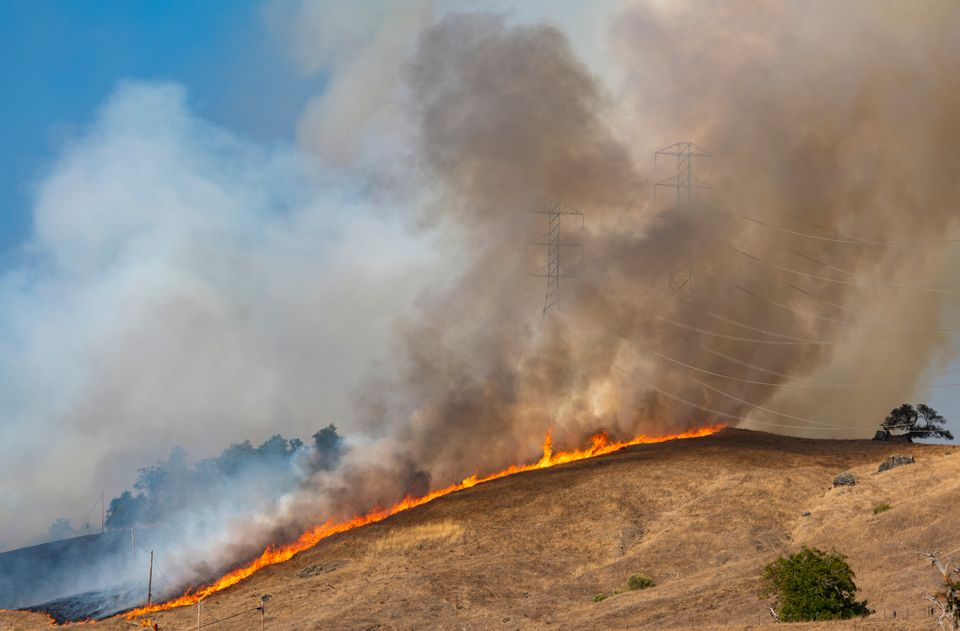 A back fire set by firefighters in an effort to control the fire in Geyserville, California, on 26