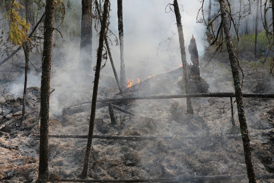 A fire in the Boguchansk district of the Krasnoyarsk region in Russia. Hundreds of Russian towns and...