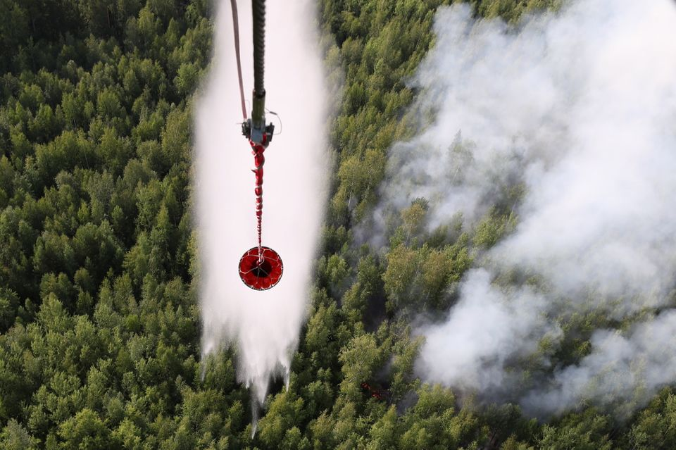 Battling a forest fire in Boguchany District, Russia, in August. More than a million hectares of woodland...