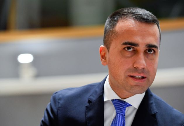 Italy's Foreign Minister Luigi Di Maio talks with his advisor during a Foreign Affairs meeting at the...