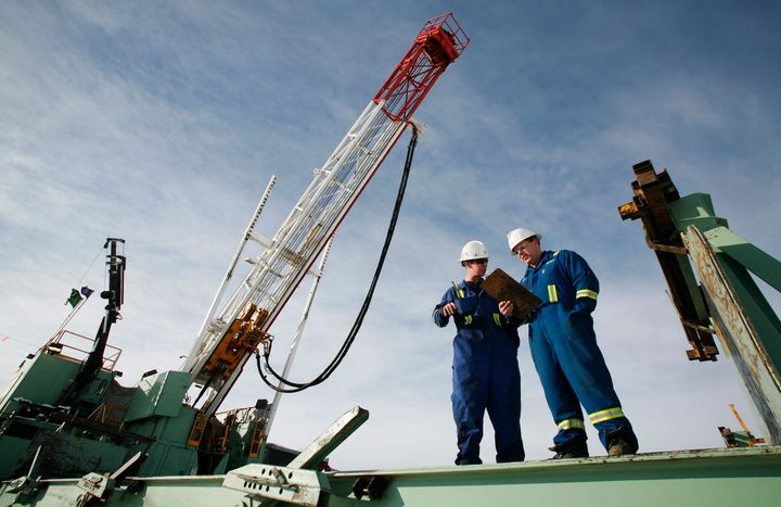 Encana employees at a gas drilling well east of Calgary, Alta., Feb. 15, 2007.