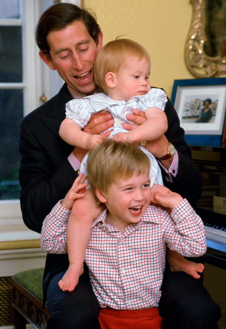 Prince Charles poses with his sons at Kensington Palace in 1985.