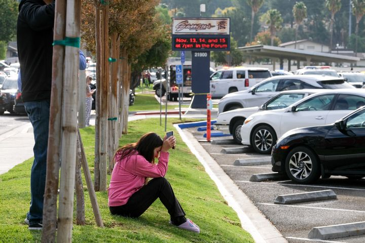 A parent waits outside of Saugus High School in Santa Clarita, California, on Thursday, after an active shooter was reported at the school around 7:30 a.m.