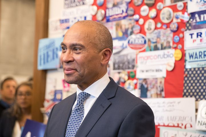 Former Massachusetts Gov. Deval Patrick stands in the visitor center of the New Hampshire State House after he filing his pap