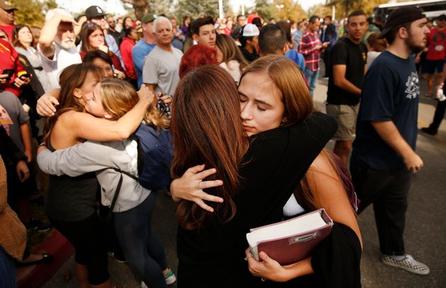 Saugus High School students are re-united with their parents at a nearby park after at least six people...