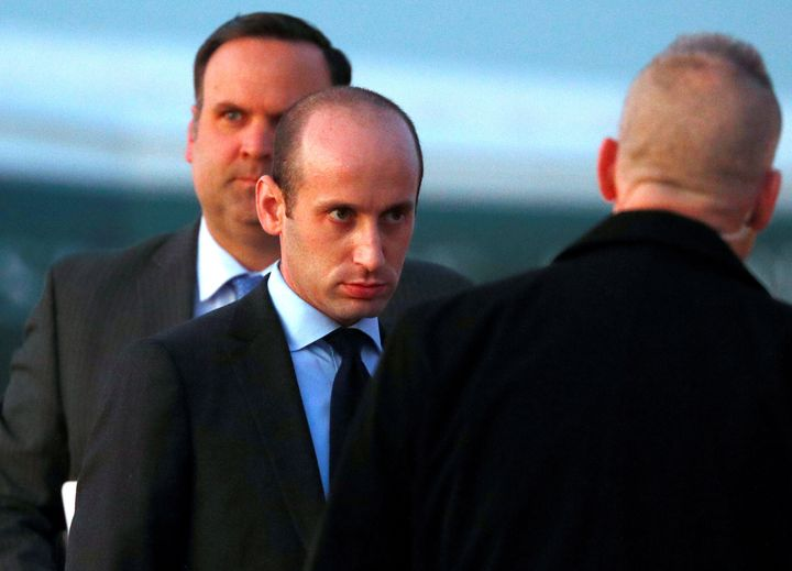 White House senior policy adviser Stephen Miller and White House director of social media Dan Scavino board Air Force One to