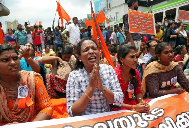 A woman chants hymns during a protest called by various Hindu organisations against the lifting of ban...