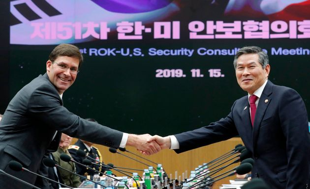 US Defense Secretary Mark Esper (L) shakes hands with South Korean Defence Minister Jeong Kyeong-doo...
