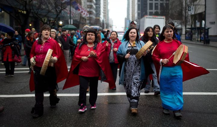 Members of the Chilcotin First Nation march in Vancouver during a protest against Taseko Mines's proposed Prosperity Mine, Dec. 13, 2013.