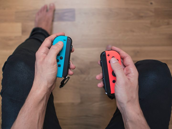 TL;DR: If you ever think you'll want the ability to play on a TV, you're better of snagging an original Switch (pictured) rather than the Switch Lite.