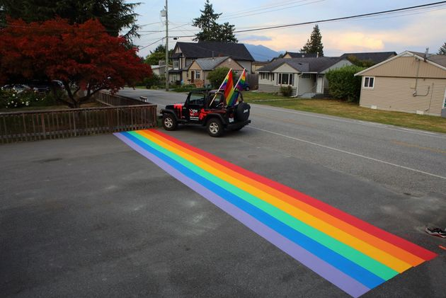 A rainbow crosswalk painted across a Chilliwack