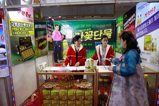 A booth of Pyongyang Taehung Trading Co. is seen during Pyongyang International Agriculture and Foodstuff...