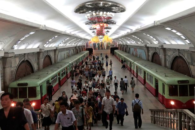 Commuters walk inside Puhung subway station in Pyongyang, North Korea, Wednesday, Sept. 11, 2019. (AP...